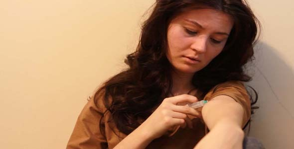 Woman Giving An Injection