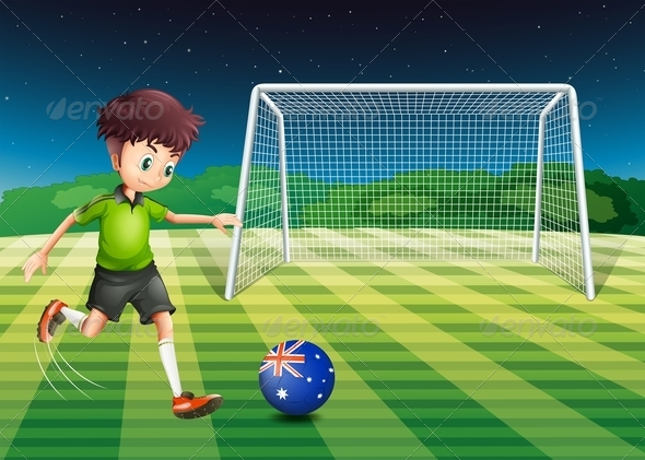 GraphicRiver A Boy Kicking the Soccer Ball at the Field 7942997