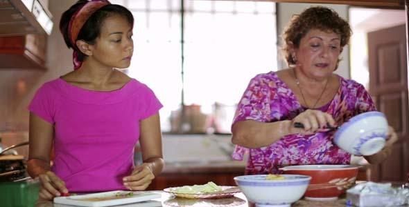 Mother & Daughter Preparing Food At Kitchen 2