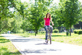 Young Woman Riding a Bike - PhotoDune Item for Sale