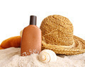Straw hat with towel and suntan lotion on white - PhotoDune Item for Sale