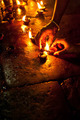 People burning oil lamps as religious ritual in Hindu temple
