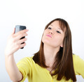 Beautiful woman taking selfies against white background - PhotoDune Item for Sale