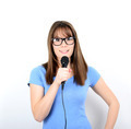 Portrait of a young female with microphone against white backgro - PhotoDune Item for Sale