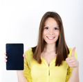 Beautiful woman showing a tablet with thumb up isolated on a whi - PhotoDune Item for Sale