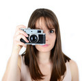 Portrait of beautiful female holding vintage camera with focus o - PhotoDune Item for Sale