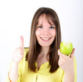 Beautiful young female holding green apple against white backgro - PhotoDune Item for Sale