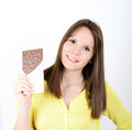 Young woman eating chocolate bar against white background - PhotoDune Item for Sale