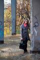 Girl standing near concrete post - PhotoDune Item for Sale