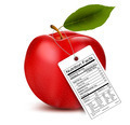 An apple with a nutrition facts label.  - PhotoDune Item for Sale