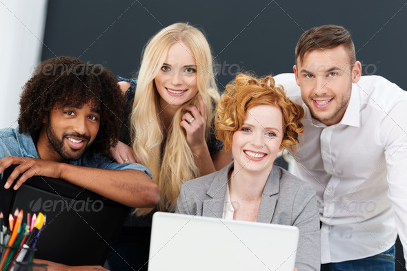 Smiling successful young multiracial business team - Stock Photo - Images