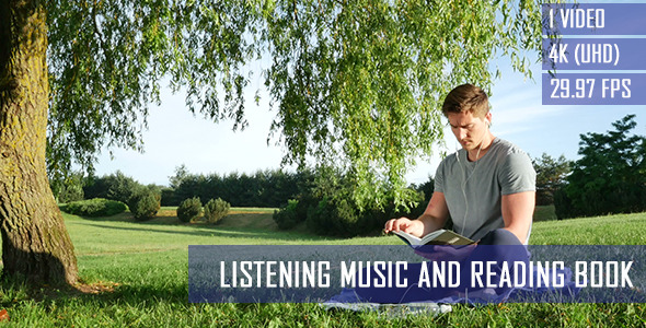 Listening Music And Reading Book In The Park