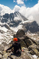 Hiker sits on top of a mountain. - PhotoDune Item for Sale