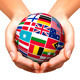 Flags of the World in Globe and Hands - GraphicRiver Item for Sale