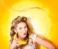 Gossiping retro pin up girl on fruit phone - PhotoDune Item for Sale