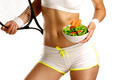 Close up of a woman measuring  hips with a salad in her hand - PhotoDune Item for Sale