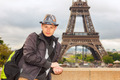 Young man hipster on the background of the Eiffel Tower, Paris - PhotoDune Item for Sale