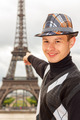 Young man hipster shows the Eiffel tower, Paris, France - PhotoDune Item for Sale