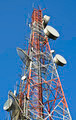 telecommunication towers with antennas against blue sky - PhotoDune Item for Sale