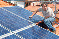 installing alternative energy photovoltaic solar panels - PhotoDune Item for Sale