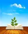 Green tree growing from open book. - PhotoDune Item for Sale