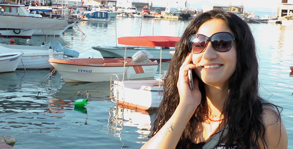 Girl Talking With Cellphone In A Dock 2
