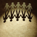 Group of paper people holding hands. - PhotoDune Item for Sale