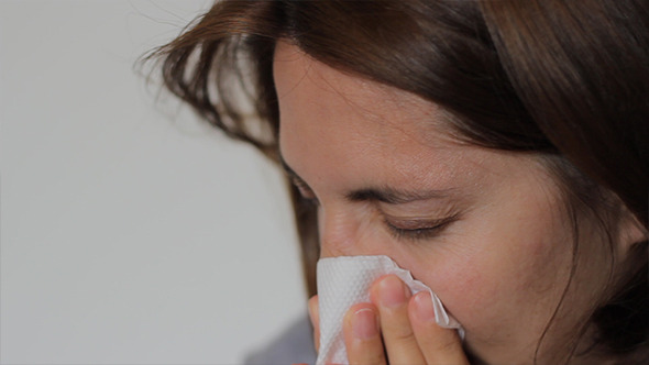 Woman is Blowing Nose