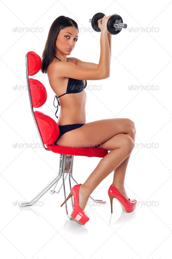Sexy Fitness woman training with dumbbells - Stock Photo - Images