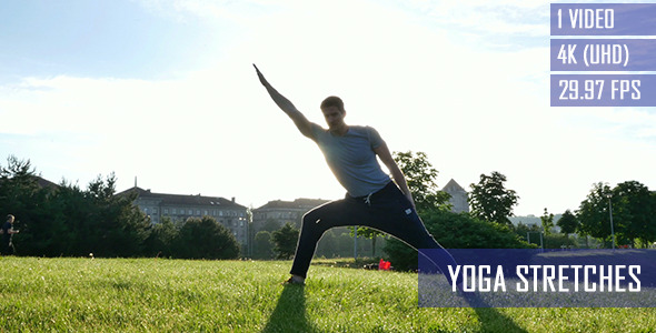Healthy Man Doing Yoga Stretches In The City Park