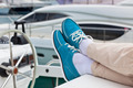 Legs in pants and bright blue topsiders on yacht - PhotoDune Item for Sale
