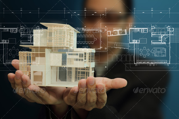 Businessman present house model and plan on touch screen - Stock Photo - Images