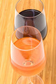 Glasses of Red and Pink Wine on Wooden Table - PhotoDune Item for Sale