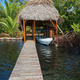 A boathouse with thatched palm roof - PhotoDune Item for Sale