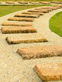 Stone walk paths in the park with green grass - PhotoDune Item for Sale