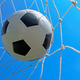 Soccer ball in goal and blue sky - PhotoDune Item for Sale
