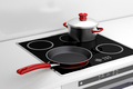 Frying pan and cooking pot at the induction stove - PhotoDune Item for Sale