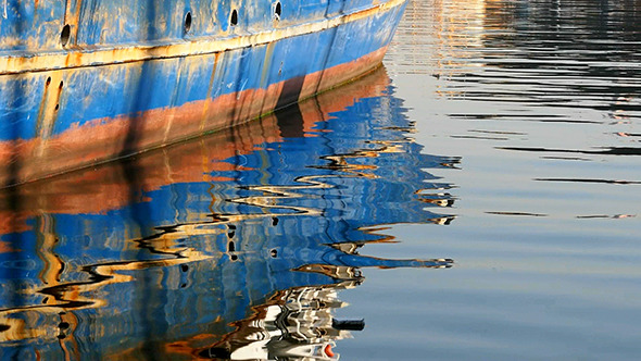 Boat Reflections On The Sea 3