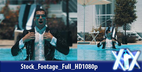 Businessman Splashing Into Pool