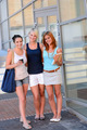 Three student girl friends outside college smiling - PhotoDune Item for Sale