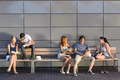 College students sitting on bench modern wall - PhotoDune Item for Sale