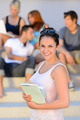 Smiling college student girl hold books summer - PhotoDune Item for Sale