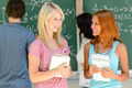 Two college student friends talking math lesson - PhotoDune Item for Sale