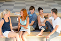 Students talking sitting on school bench - PhotoDune Item for Sale