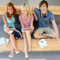 Three college students looking camera top view - PhotoDune Item for Sale