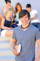 Smiling college student boy friends in background - PhotoDune Item for Sale
