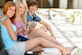 Three college student friends with tablet smiling - PhotoDune Item for Sale