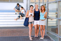 Student girl friends smiling front of college - PhotoDune Item for Sale
