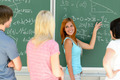 Students standing front of green chalkboard math - PhotoDune Item for Sale