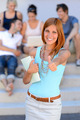 Smiling student girl thumb-up friends background - PhotoDune Item for Sale